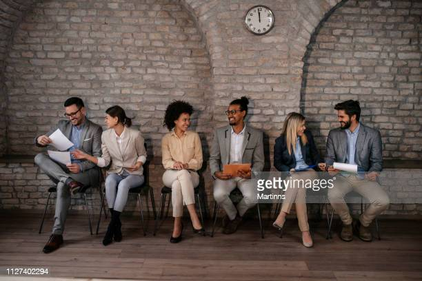 candidates await an interview for the job - candidate stock pictures, royalty-free photos & images
