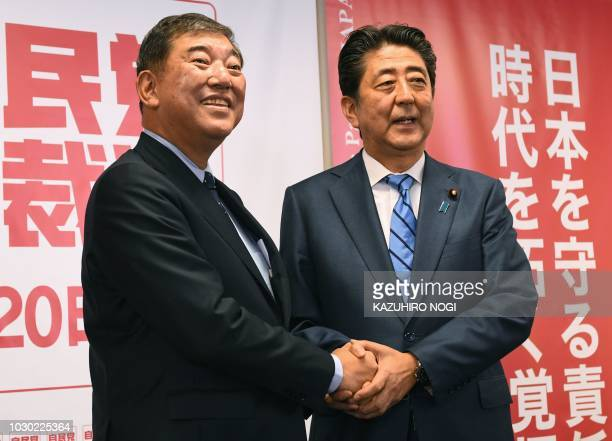 Candidates for the Liberal Democratic Party presidential election Japan's Prime Minister Shinzo Abe and former Defense Minister Shigeru Ishiba shake...