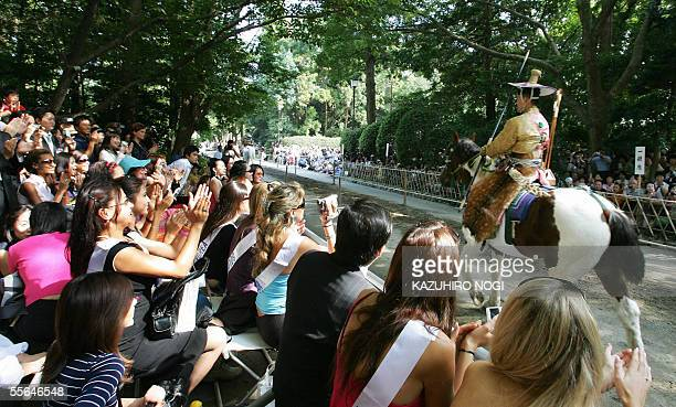 Candidates for the Miss International applause a rider during an annual shito festival 'Yabusame' Japanese traditional archery on horseback at the...