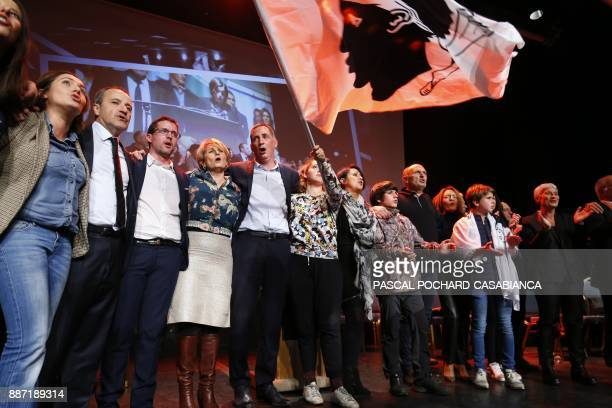 Candidates for the Pe a Corsica nationalist party for Corsican regional elections Josepha Giacometti Jean Guy Talamoni Petr Anto Tomasi and Gilles...