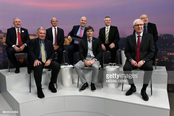 Candidates for the upcoming presidential election in Czech Republic pose on a set before a political debate at the CNC/Czech News Center media house...