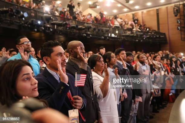 Candidates for US citizenship are administered the Oath of Allegiance by US Supreme Court Justice Ruth Bader Ginsburg for US citizenship at the...