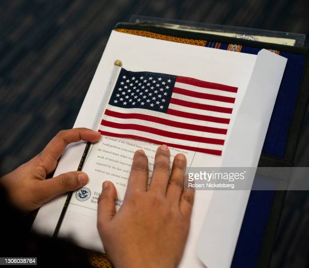 Candidates for U.S. Citizenship listen to the presiding field officer during a naturalization ceremony March 8, 2021 in Newark, Jersey. Twenty-one...