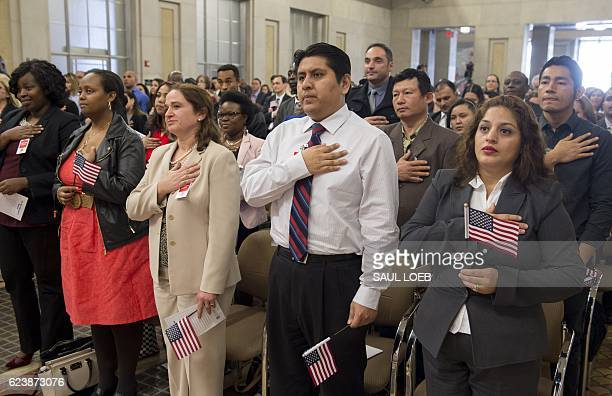 Candidates for US citizenship take the oath of allegiance to become US citizens during a Naturalization Ceremony for new US Citizens at the...