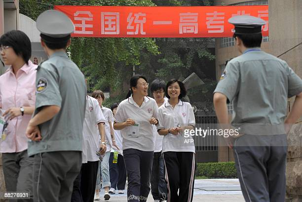 Candidates leave following a morning examination at the exam site of the national college entrance examination in Beijing on June 7 2009 The annual...