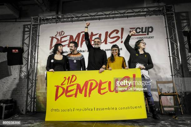 Candidates of the Catalan proindependence anticapitalist party 'Candidatura d'Unitat Popular CUP' Eulalia Reguant Maria Rovira and Carles Riera stand...