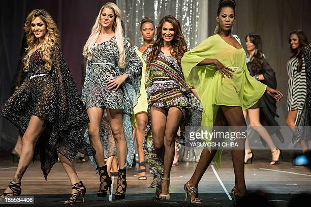 Candidates perform on stage during the Miss T Brasil 2013 transgender beauty pageant in Rio de Janeiro on October 22 2013 The Association of...