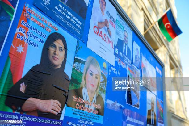Candidates' posters line on a billboard ahead of the upcoming Parliamentary elections in Azerbaijan on February 09 2020 in Baku Azerbaijan In the...