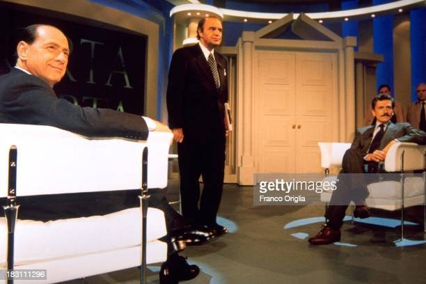 Candidates Prime Minister Silvio Berlusconi and Massimo D'Alema and presenter Bruno Vespa attend talk show 'Porta A Porta' on tv channel Rai Uno as...
