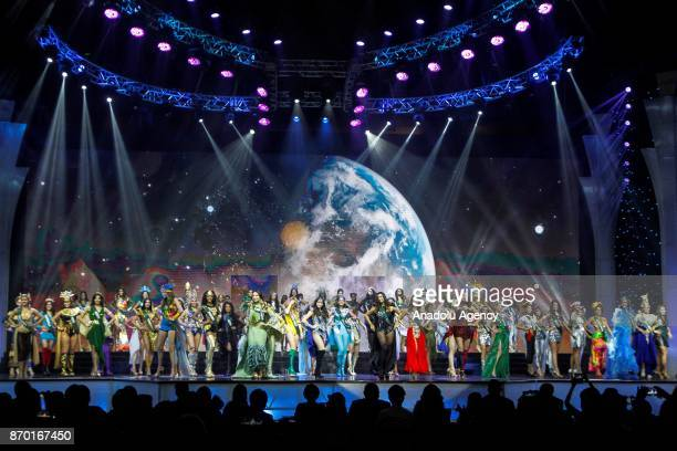 Candidates representing their respective countries grace the stage during the Miss Earth 2017 coronation night at the Mall of Asia Arena in Pasay...