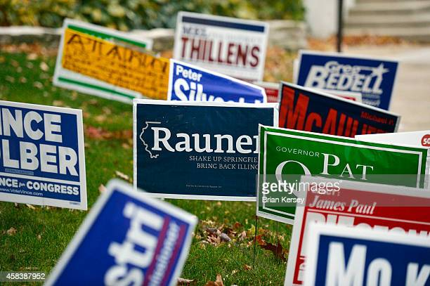 Candidates' signs line the sidewalk outside of a polling place on November 4 2014 in Park Ridge Illinois Illinois voters are selecting a governor and...