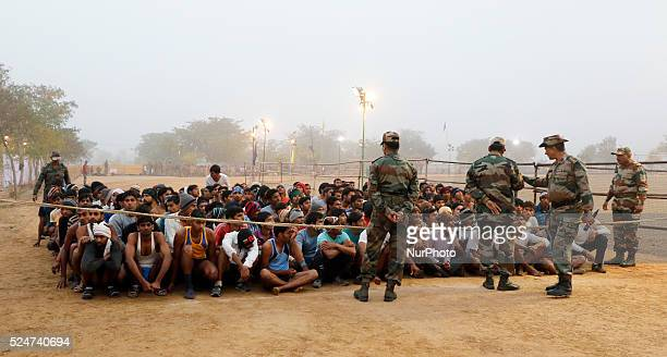 Candidates wait during the Indian Army recruitment rally at Amber Kunda village in Jaipur on 16 Jan2016