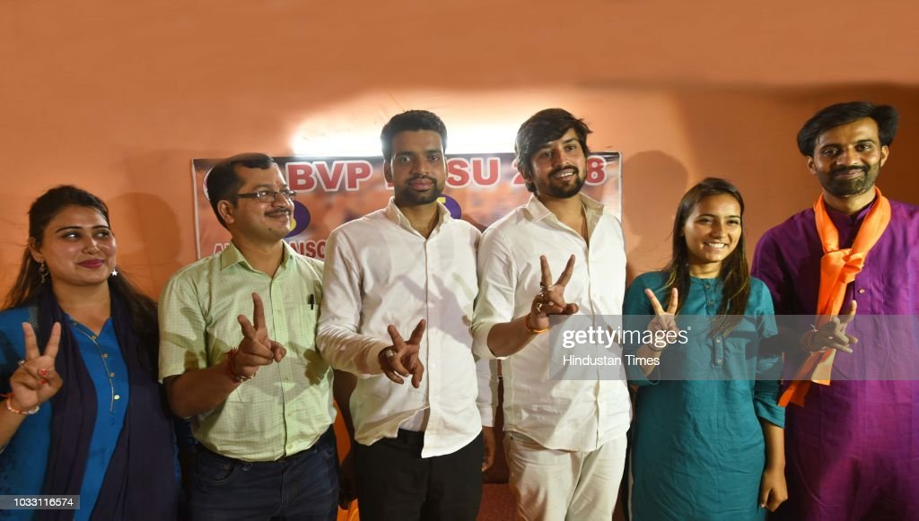 ABVP candidates, who won in the Delhi University Students Union (DUSU) elections, President Ankiv Baisoya (C), Vice President Shakti Singh (3R), and Join Secretary Jyoti Chaudhary (2R) along with ABVP's Delhi State President Avneesh Mittal (2L), State Secretary Bharat (R), and State Spokesperson Monika (L) during a press conference at Deen Dayal Upadhyay Marg, on September 14, 2018 in New Delhi, India. ABVP's Ankiv Basoya won the presidential post with a margin of 1744 votes while party's candidate Shakti Singh was declared as the vice president after he won with a margin of 7673 votes. NSUI's Akash Choudhary won the secretary's post while ABVP's Jyoti emerged victorious on the joint secretary post.