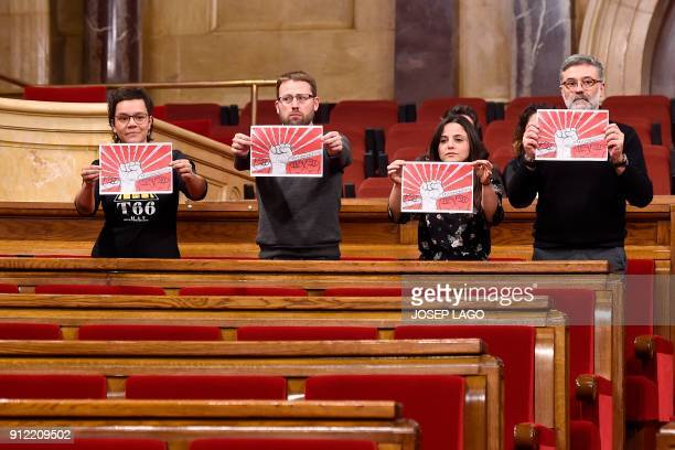 'Candidatura d'Unitat Popular CUP' parliament members Natalia Sanchez Vidal Aragones Maria Sirvent and Carles Riera hold posters reading 'People's...