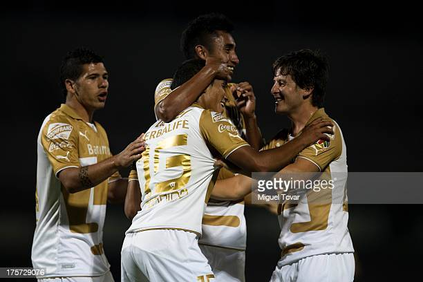 Candido Ramirez ans his teammates of Pumas celebrates a goal against Leones Negros during a match between Pumas and Leones Negros as part of the Copa...