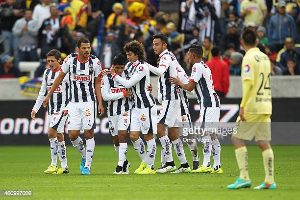 Candido Ramirez of Monterrey celebrates with teammates after scoring his team's second goal during a friendly match between America and Monterrey at...