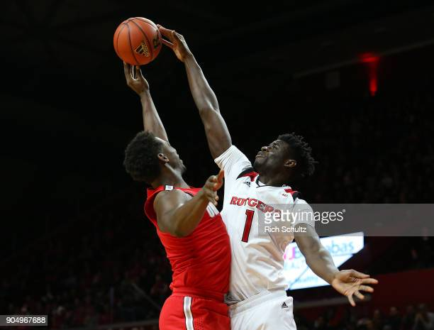 Candido Sa of the Rutgers Scarlet Knights blocks the shot of Jae'Sean Tate of the Ohio State Buckeyes during the first half of a game at Rutgers...