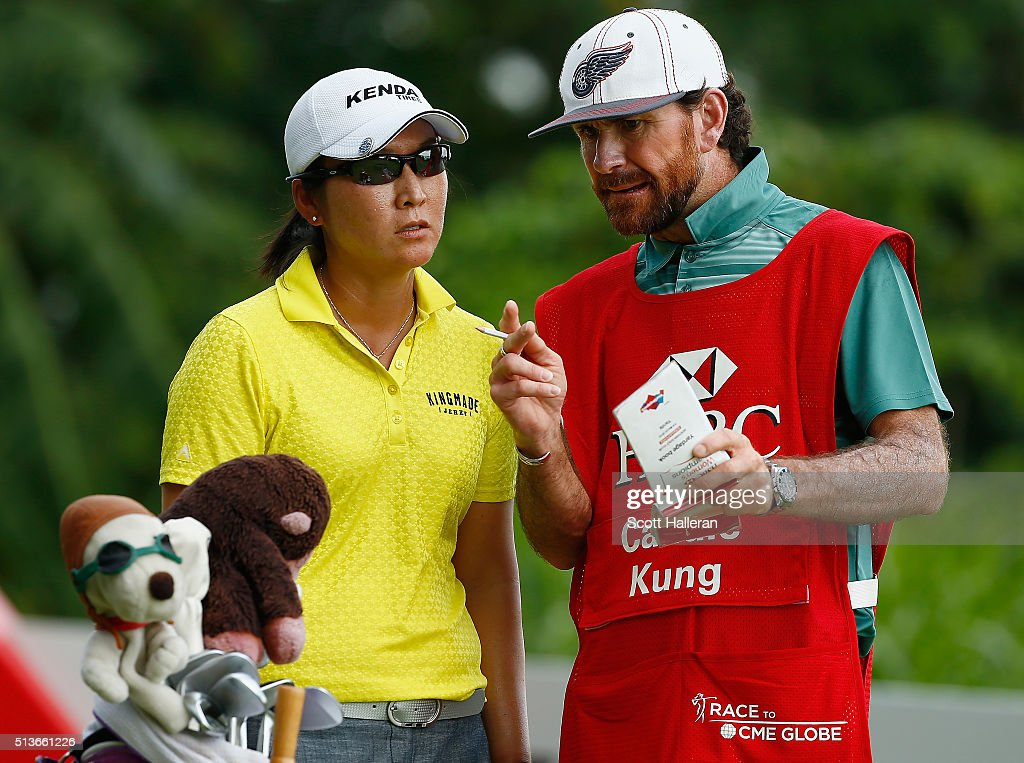 Candie Kung of the United States chats with her caddie Thad Kael on the fifth hole during the second round of the HSBC Women's Champions at Sentosa Golf Club on March 4, 2016 in Singapore.