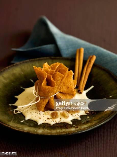 Candied chestnut purse with cinnamon-flavored Raschera cheese sauce