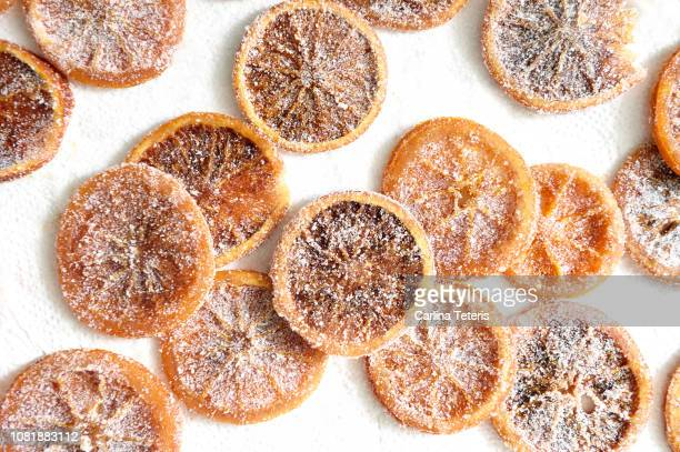 candied orange slices on parchment paper - glazed food stock pictures, royalty-free photos & images