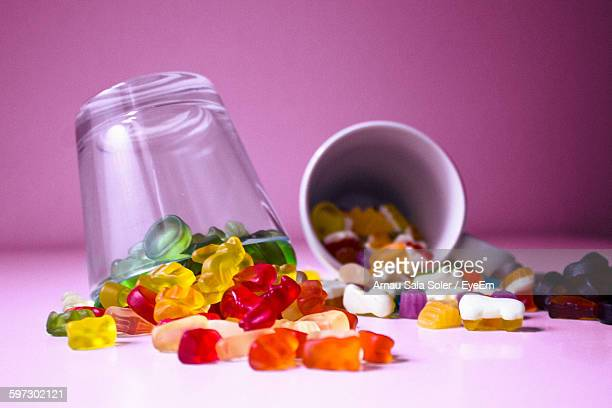 candies and containers on table - gummi bears fotografías e imágenes de stock