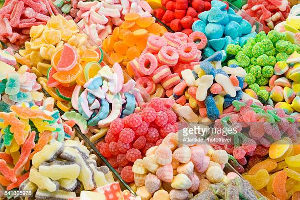 candies at la boqueria market in barcelona - sweet shop stock pictures, royalty-free photos & images