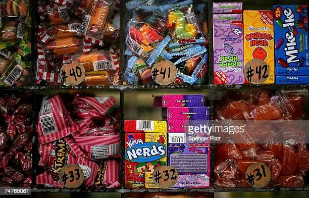 Candies just some of the sundry items sold at bodegas are displayed at a store around the corner from where Bolivar Cruz was killed while working at...