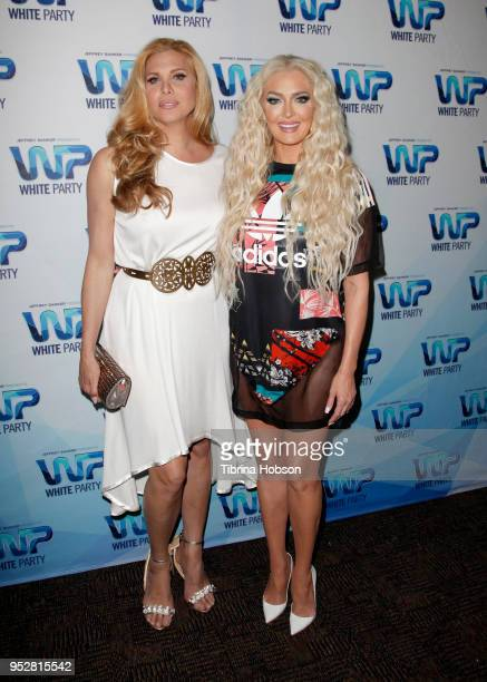 Candis Cayne and Erika Jayne attend Jeffrey Sanker's 2018 White Party on April 28 2018 in Palm Springs California