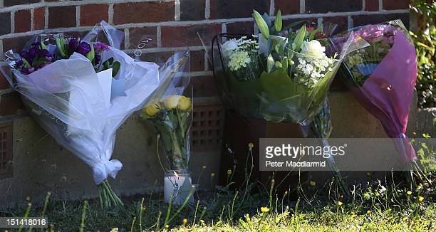 A candle and floral tributes from well wishers are placed at the house of the alHilli family on September 7 2012 in Claygate England French police...