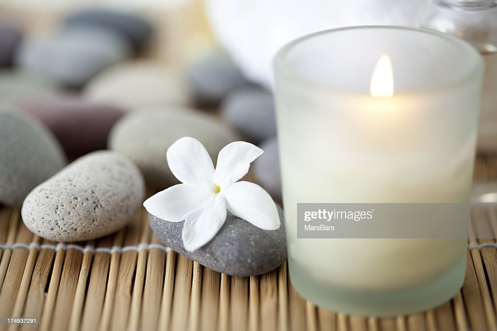 Candle and flower at spa