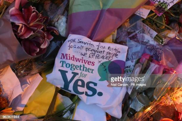 Candle and flowers are placed in front of a mural of Savita Halappanavar in Dublin as Ireland has voted to repeal the 8th Amendment of the Irish...