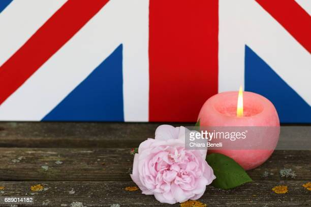 candle and pink rose