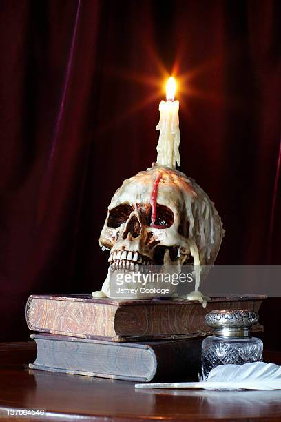 Candle and Skull on Books