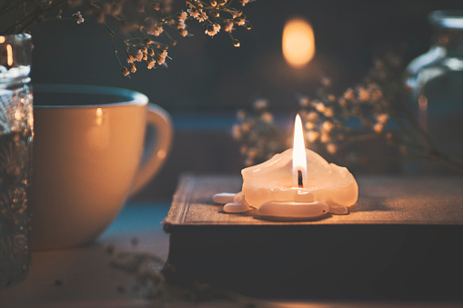 Candle, book and flowers - gettyimageskorea