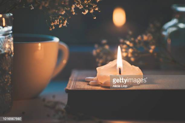 Candle, book and flowers