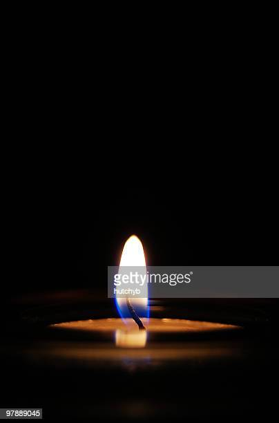 candle burning - candle in the dark stock pictures, royalty-free photos & images