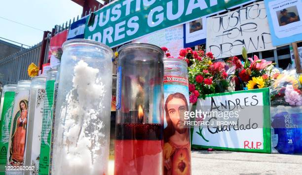 Candle burns at a makeshift memorial for Andres Guardado on June 23, 2020 in Gardena, California near where he was fatally shot by an LA County...
