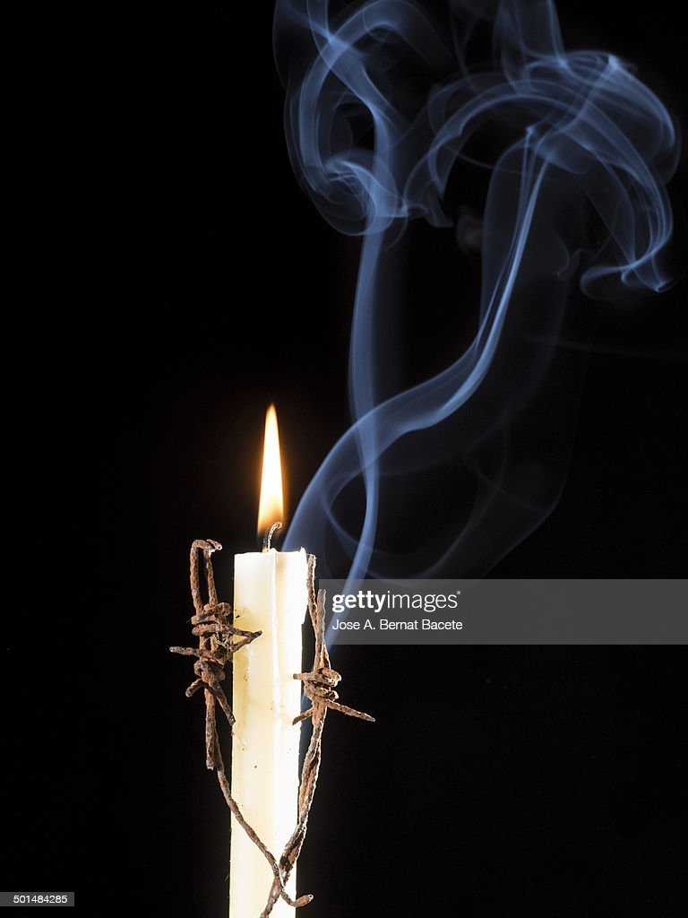 Candle Coiled In Barbed Wire And Figures Of Smoke Stock Photo ... for Candle Smoke Photography  45ifm