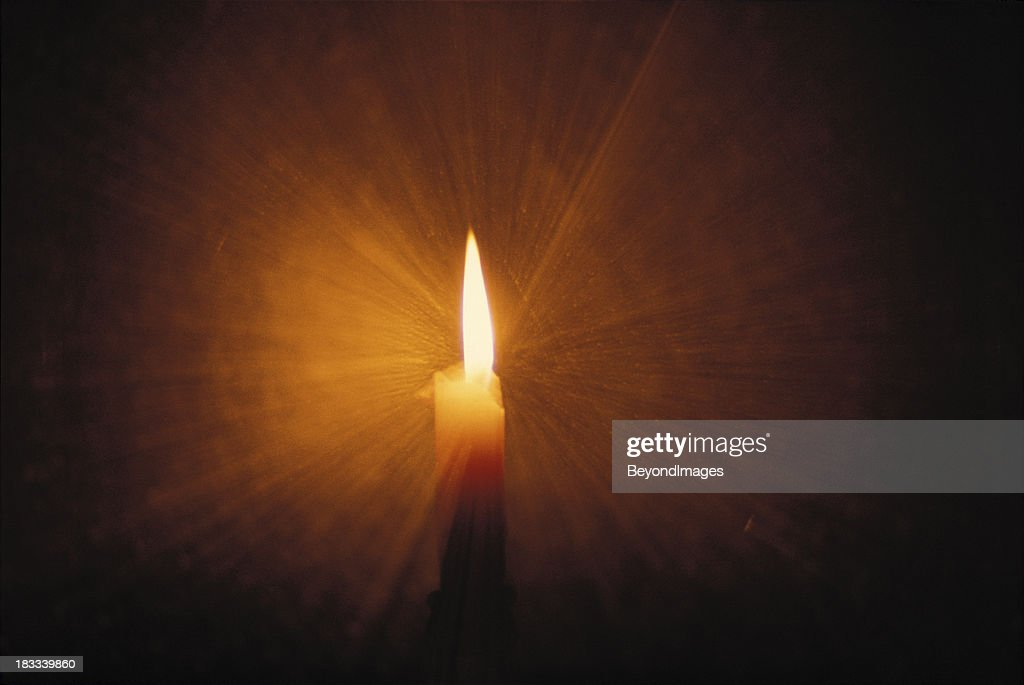 Candle flame light rays : Stock Photo
