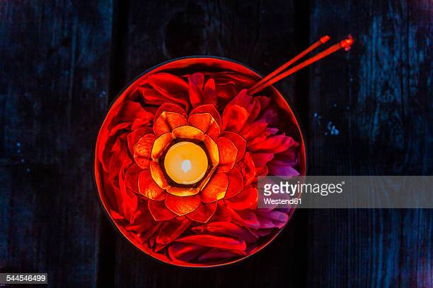 Candle in a bowl with petals