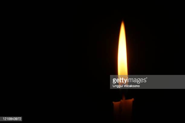 candle in black background close up - images of brazilian wax stock pictures, royalty-free photos & images