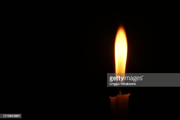 candle in black background - images of brazilian wax stock pictures, royalty-free photos & images