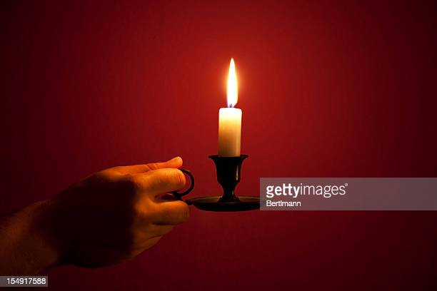candle in hand - cult stock pictures, royalty-free photos & images