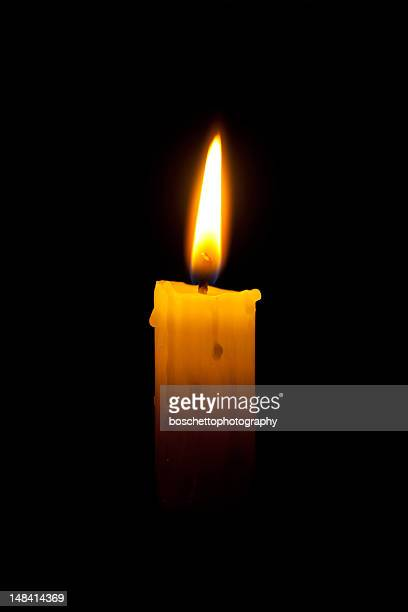 candle in the dark - candle in the dark stock pictures, royalty-free photos & images