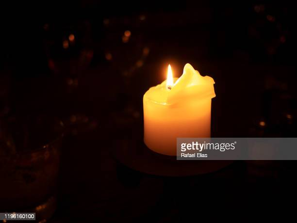 candle in the night - candle of hope stock pictures, royalty-free photos & images