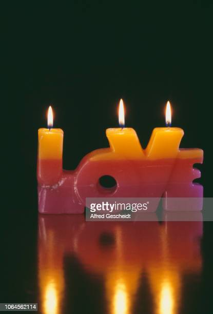 A candle in the shape of the word 'Love' US circa 1985