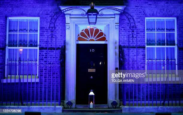 Candle is lit and placed on the doorstep of 10 Downing Street in central London on July 4, 2020 in honour of the tens of thousands of people who have...