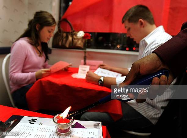 A candle is lit near the table of Leslie Adams and Rob Dockery during a Valentine's Day dinner at a White Castle restaurant February 14 2006 in Des...