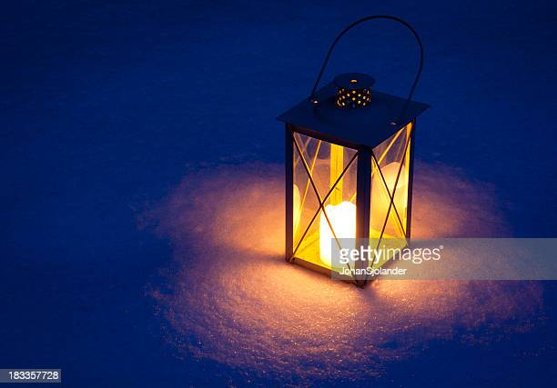 candle lamp isolated in snow at night - lantern stock pictures, royalty-free photos & images
