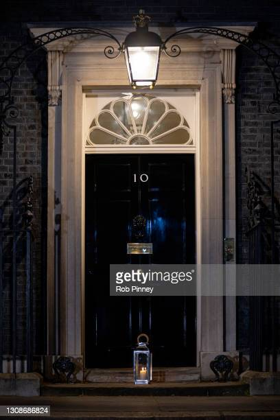 Candle lantern on the doorstep of 10 Downing Street on March 23, 2021 in London, England. Marie Curie Cancer Charity has organised a National Day of...
